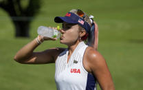 Lexi Thompson, of the United States, refreshes during the first round of the women's golf event at the 2020 Summer Olympics, Wednesday, Aug. 4, 2021, at the Kasumigaseki Country Club in Kawagoe, Japan. (AP Photo/Andy Wong)