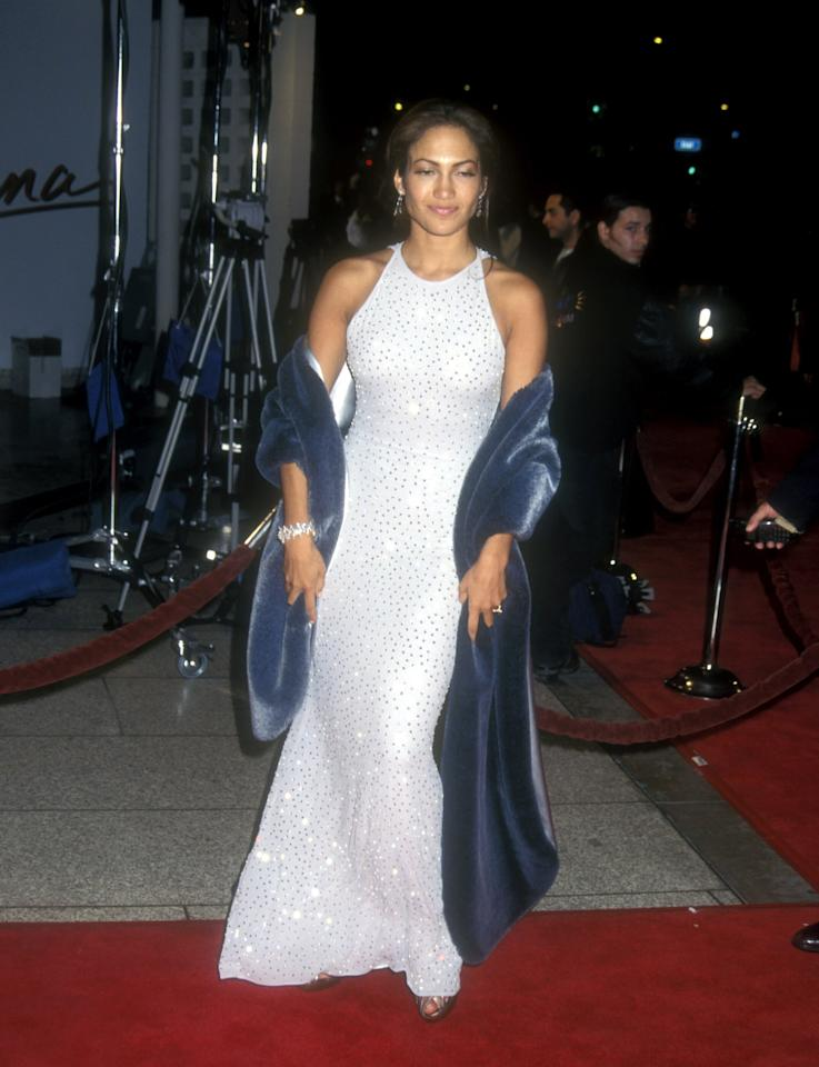 "<p>We'll never forget the halter-style gown Jennifer wore to <a href=""https://www.popsugar.com/latina/Selena-Premiere-1997-Photos-43331234"" class=""ga-track"" data-ga-category=""Related"" data-ga-label=""https://www.popsugar.com/latina/Selena-Premiere-1997-Photos-43331234"" data-ga-action=""In-Line Links"">the 1997 premiere of <strong>Selena</strong> in Hollywood</a>. The dress featured tiny crystals stitched all over, and she coordinated it with a furry blue stole.</p>"