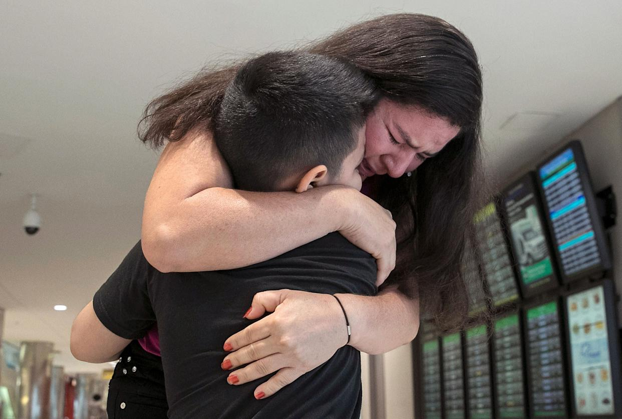Seven-year-old Andy is reunited with his mother, Arely, at Baltimore-Washington International Airport July 23, 2018 in Linthicum, Maryland. Originally from El Salvador, the mother and son were separated upon entering the United States on June 13. (Photo: Win McNamee via Getty Images)
