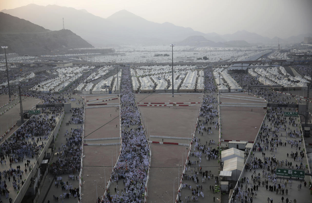 <p>Muslim pilgrims walk from their camps in Mina to cast stones at three huge stone pillars in the symbolic stoning of the devil, outside the holy city of Mecca, Saudi Arabia, Saturday, Sept. 2, 2017. (Photo: Khalil Hamra/AP) </p>