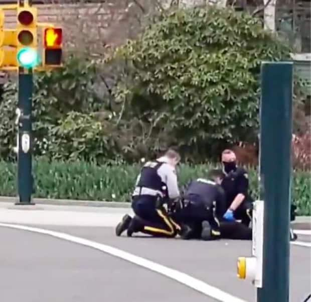 This image, submitted by bystander Rylan Harvey, appears to show police apprehending a suspect on Saturday in North Vancouver.