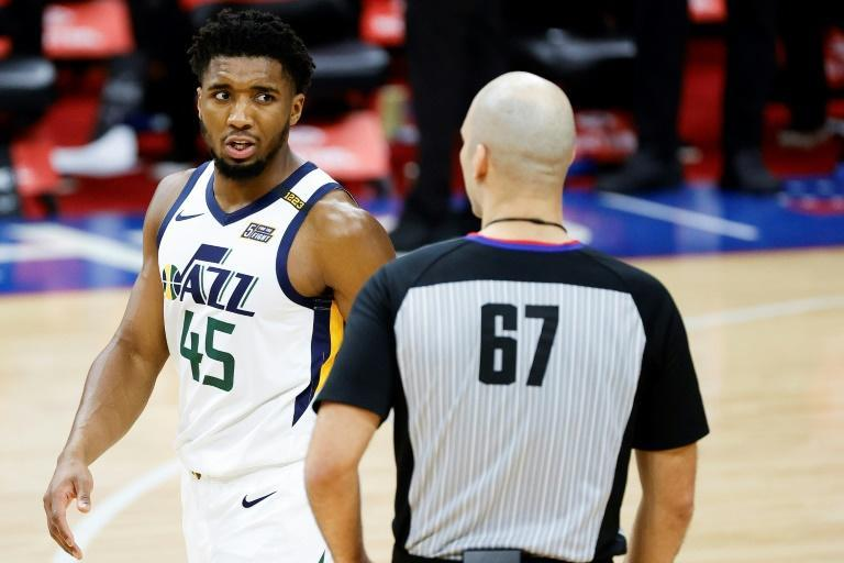 Utah's Donovan Mitchell, left speaking with referee Brandon Adair, was fined $25,000 by the NBA on Friday for complaining about officiating in a Wednesday loss at Philadelphia while teammate Rudy Gobert was fined $20,000
