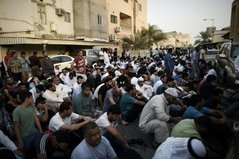 Bahrainis take part in a protest against the revocation of the citizenship of top Bahraini Shiite cleric Sheikh Isa Qassim, on June 20, 2016 in the village of Diraz, west of Manama