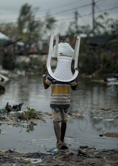 A child returning to his devastated village - Credit: Josh Estey/CARE
