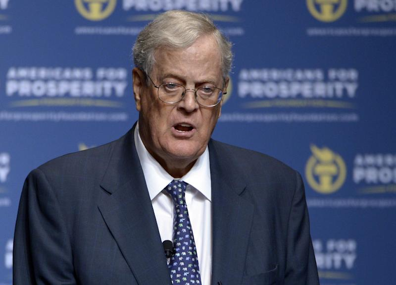 """FILE - In this Aug. 30, 2013 file photo, Americans for Prosperity Foundation Chairman David Koch speaks in Orlando, Fla. Democratic Senate candidates are gambling they can turn voters against two obscure billionaire brothers who are funding attacks on them and the president's health care law. Democrats are denouncing Charles and David Koch two of world's richest people. The pair's political network is spending millions on TV ads hitting Democrats in North Carolina and several other states. Senate Majority Leader Harry Reid says the Kochs are paying huge sums to try to """"buy"""" elections and advance a self-serving agenda of low taxes and less regulation. (AP Photo/Phelan M. Ebenhack, File)"""