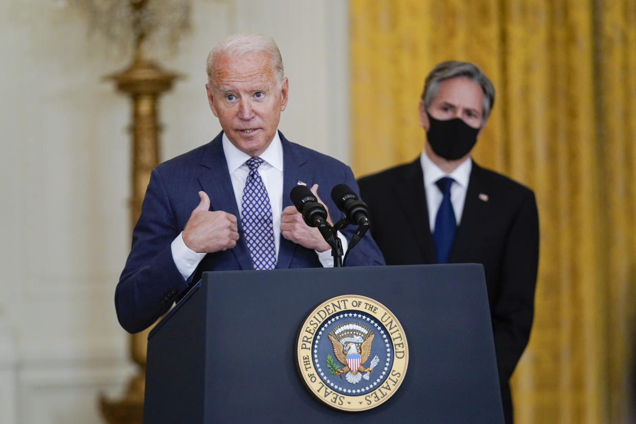 President Biden takes questions from the media about the evacuation of American citizens from Afghanistan on Friday, with Secretary of State Antony Blinken at right.