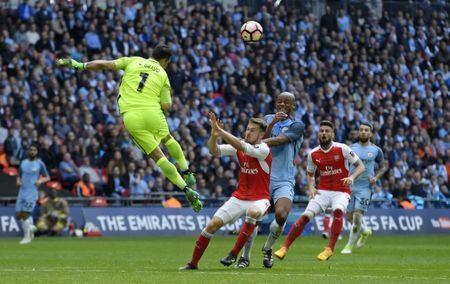 Britain Football Soccer - Arsenal v Manchester City - FA Cup Semi Final - Wembley Stadium - 23/4/17 Manchester City's Claudio Bravo and Vincent Kompany in action with Arsenal's Aaron Ramsey Reuters / Toby Melville Livepic
