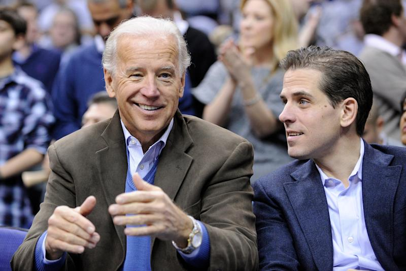 Hunter Biden, seen here with his father, former Vice President Joe Biden at a 2010 basketball game, has remarried, the family confirmed Wednesday.