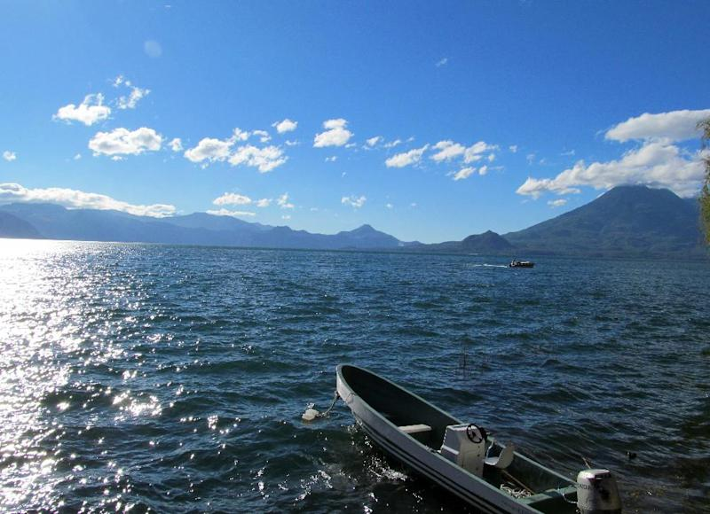 This February 2013 photo shows Lake Atitlan, in Guatemala's western highlands, surrounded by volcanoes Tomilan and Atitlan. Tourists can spend a day shuttling on local boats between the lake's small towns, each of which has a particular character. (AP Photo/Amir Bibawy)