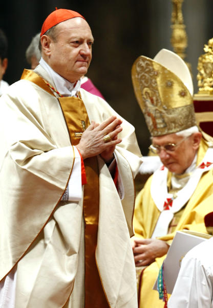 FILE - In this file photo, taken at the Vatican on Nov. 21 2010, Cardinal Gianfranco Ravasi walks past Pope Benedict XVI after receiving Cardinal's ring during a mass in St. Peter's Basilica. He looks to Amy Winehouse for inspiration and, unlike Benedict XVI, actually taps out his tweets himself. Cardinal Gianfranco Ravasi is an erudite scholar with a modern touch _ and that is seen by some as just the combination the Catholic Church needs to revive a church beset by scandal and a shrinking flock. (AP Photo/Pier Paolo Cito)