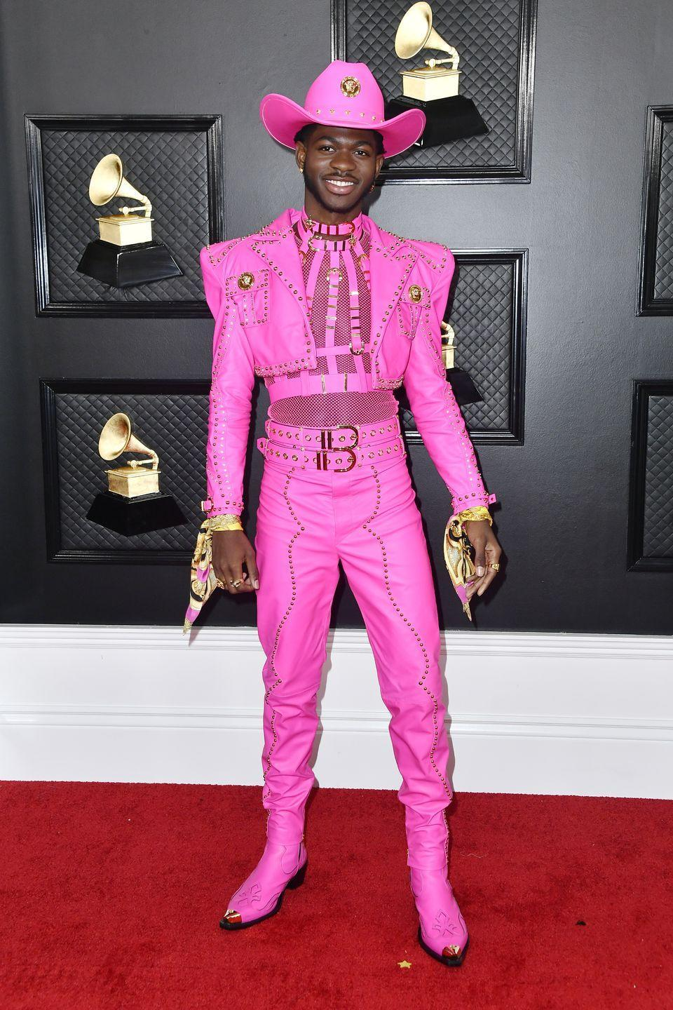 <p>For his first-ever Grammy's red carpet look, Lil Nas went full-out pretty in pink in Versace. He paired his sheer top with a cropped jacket and buckled details. Elle Woods would approve.</p>