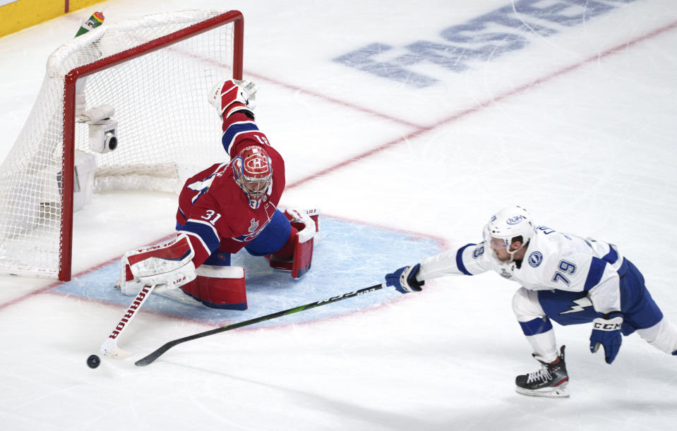 Montreal Canadiens goaltender Carey Price clears the puck away from Tampa Bay Lightning's Ross Colton (79) during the third period of Game 3 of the NHL hockey Stanley Cup Final, Friday, July 2, 2021, in Montreal. (Paul Chiasson/The Canadian Press via AP)