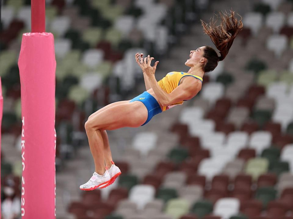 Maryna Kylypko of Team Ukraine yells while falling down in the pole vault.