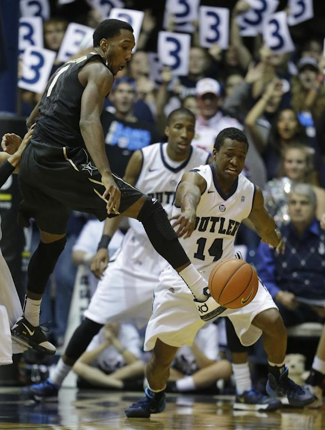 Vanderbilt's Eric McClellan, left, has the basketball stripped by Butler's Rene Castro (14) during the first half of an NCAA college basketball game Tuesday, Nov. 19, 2013, in Indianapolis. (AP Photo/Darron Cummings)