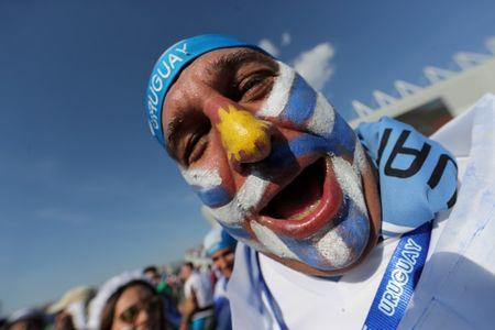 Uruguay fan. REUTERS/Marcos Brindicci