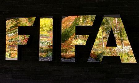 FILE PHOTO: FIFA's logo is seen in front of its headquarters during a meeting of the FIFA executive committee in Zurich, Switzerland September 25, 2015. REUTERS/Arnd Wiegmann/File Photo