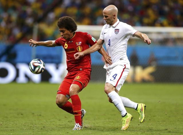 Belgium's Axel Witsel fights for the ball with Michael Bradley of the U.S. during the 2014 World Cup round of 16 game between Belgium and the U.S. at the Fonte Nova arena in Salvador July 1, 2014. REUTERS/Marcos Brindicci (BRAZIL - Tags: SOCCER SPORT WORLD CUP)