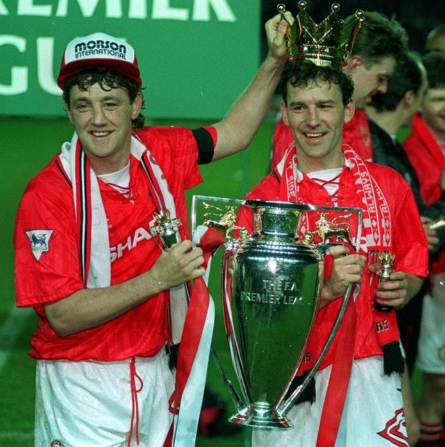 Manchester United captain Steve Bruce and Bryan Robson with the Premier League trophy