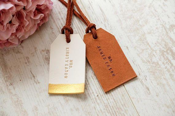 """Get them <a href=""""https://www.etsy.com/listing/292020657/mr-and-mrs-luggage-tag-custom-couple?source=aw&utm_source=affiliate_window&utm_medium=affiliate&utm_campaign=us_location_buyer&awc=6220_1520864019_fa08d7a7d86b4447f38e6f5f437667c0&utm_content=78888"""" target=""""_blank"""">here</a>."""