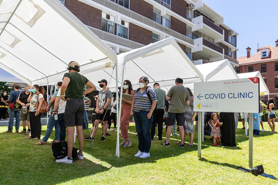 Members of the public queue outside a Covid-19 testing centre at the Royal Perth Hospital in Perth. Source: AAP