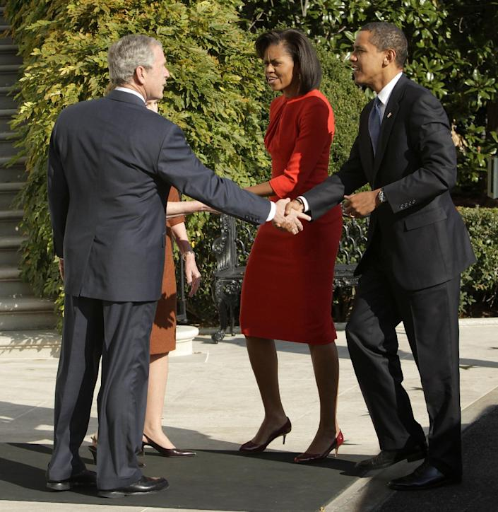 FILE - In this Nov. 10, 2008 file photo, President and Mrs. Bush greet President-elect Obama and Michelle Obama at the White House in Washington. President Barack Obama frequently blames President George W. Bush for America's shaky economy, high unemployment and foreign policy woes. But he's sure to change his tune on Thursday when Bush comes back to the White House in a rare limelight moment, The man who led the country for eight tumultuous years will have his portrait hung and Obama will be there applauding. (AP Photo/Evan Vucci, File)