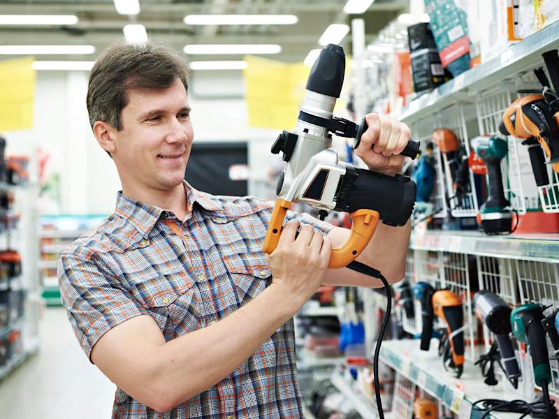 A customer tries out a power tool.