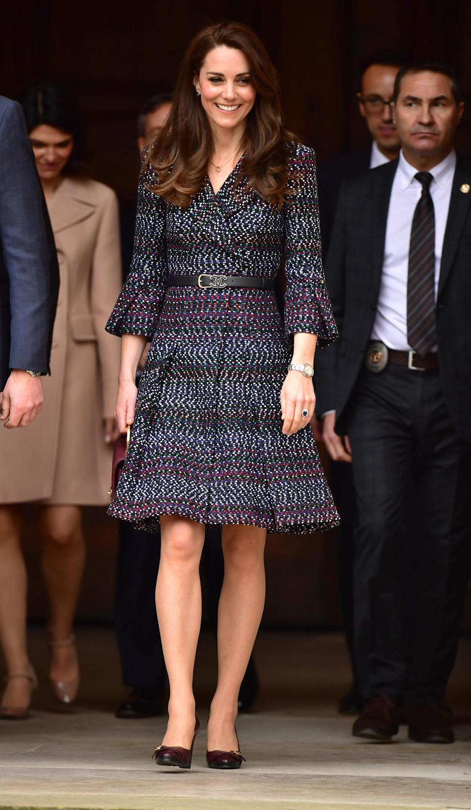 <p>When in Paris, why not wear multiple Chanel pieces? For her last day in the French capital, the Duchess wore a tweed coat dress by the Parisian brand with a Chanel logo belt and quilted burgundy bag. Chanel shoes weren't on the menu for Kate chose her trusty fringed leather pumps by Tod's. </p><p><i>[Photo: PA]</i> </p>