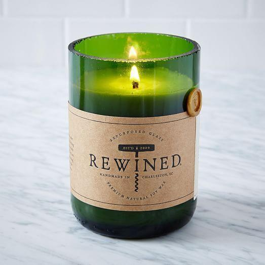 "<p><strong>Rewined</strong></p><p>westelm.com</p><p><strong>$24.00</strong></p><p><a href=""https://go.redirectingat.com?id=74968X1596630&url=https%3A%2F%2Fwww.westelm.com%2Fproducts%2F641134&sref=https%3A%2F%2Fwww.delish.com%2Fholiday-recipes%2Fg2582%2Fwine-gifts%2F"" rel=""nofollow noopener"" target=""_blank"" data-ylk=""slk:BUY NOW"" class=""link rapid-noclick-resp"">BUY NOW</a></p><p>These all-natural soy candles have a subtle, wine-inspired look and scent. They also burn for up to 80 hours.</p>"