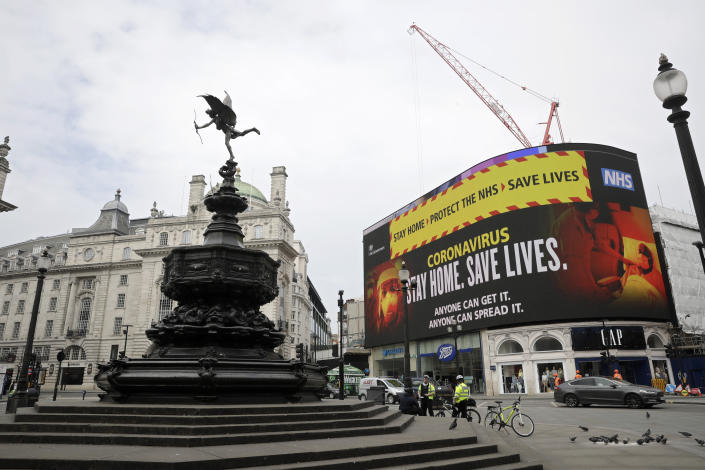 A video screen displays a message urging people to stay home, at Piccadilly Circus in London, Wednesday, April 8, 2020. The highly contagious COVID-19 coronavirus has impacted on nations around the globe, many imposing self isolation and exercising social distancing when people move from their homes. (AP Photo/Matt Dunham)