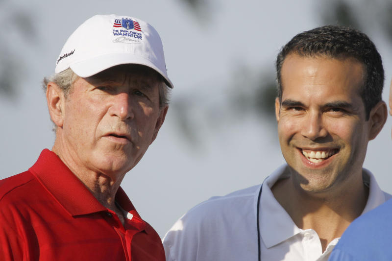 FILE - In this Monday, Sept. 24, 2012, file photo George P. Bush, right, stands with his uncle former President George W. Bush, left, during the Bush Center Warrior Open in Irving, Texas. George P. Bush, the 36-year-old attorney from Fort Worth and son of former Florida Gov. Jeb Bush has taken steps toward seeking elected office in Texas, and his father has said his son is considering a run for the state's land commissioner.  (AP Photo/LM Otero, File)
