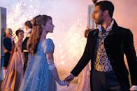 <p>Daphne and the Duke share a moment under the fireworks (er... with fireworks?). How pretty is her baby blue puff sleeve gown? Not to mention her dance partner...</p>