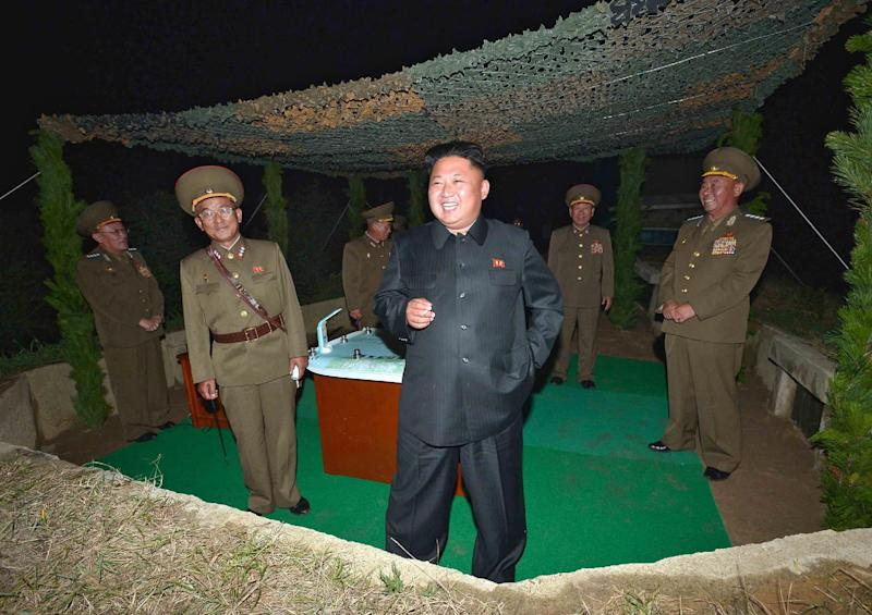 "This picture released by North Korea's official Korean Central News Agency (KCNA) shows North Korean leader Kim Jong-Un (centre) inspecting a ""rocket-firing drill"" on July 26, 2014 (AFP Photo/)"