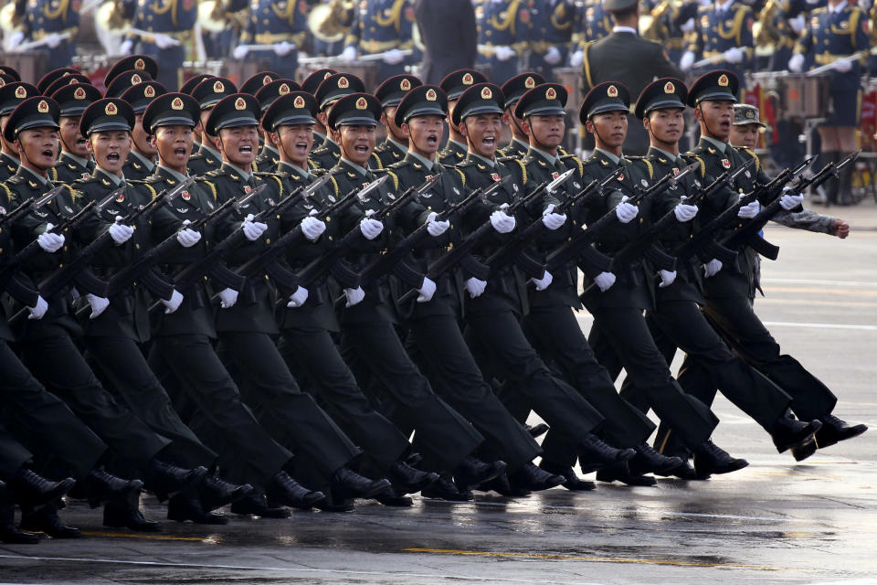 Chinese soldiers rehearse before the start of a parade to mark the 70th anniversary of the founding of the People's Republic of China in Beijing.