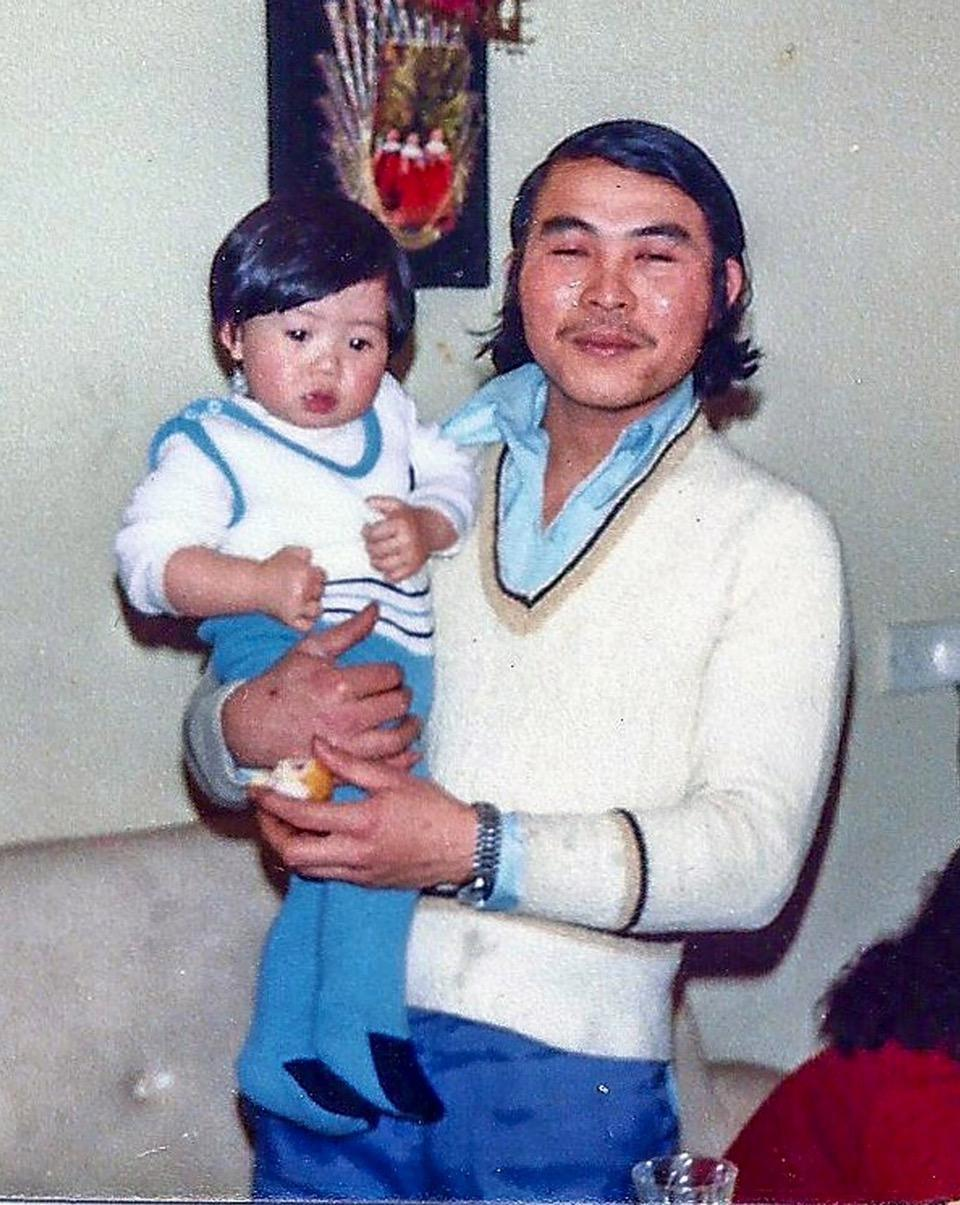 John Nguyen as a child with his father Peter. John says he regrets not asking Peter how he felt when he was born (John Nguyen)