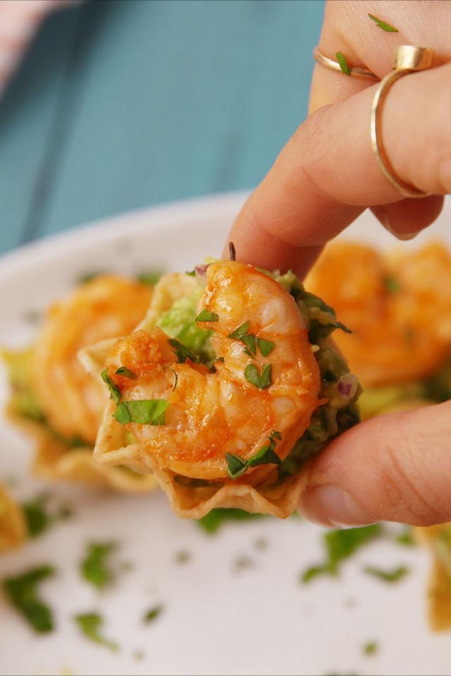 """<p>The perfect summer appetizer.</p><p>Get the recipe from <a rel=""""nofollow"""" href=""""http://www.delish.com/cooking/recipe-ideas/recipes/a53743/shrimp-tostada-bites-recipe/"""">Delish</a>.</p><p><strong><em>BUY SOME TONGS: Set Of 3 Stainless Steel Tongs, $17; <a rel=""""nofollow"""" href=""""http://buy.geni.us/Proxy.ashx?TSID=21947&GR_URL=https%3A%2F%2Fwww.amazon.com%2FTongs-Non-Stick-Stainless-Silicone-Kitchen%2Fdp%2FB010L2BVJA%3Ftag%3Ddelish_auto-append-20%26ascsubtag%3Ddelish.article.53743"""">amazon.com</a></em></strong></p>"""