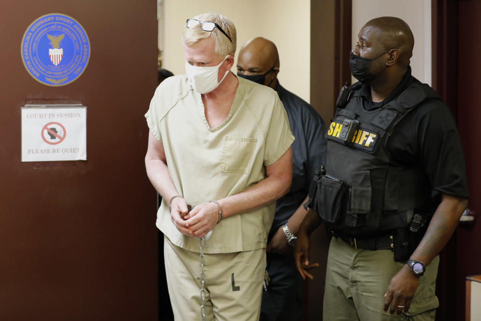 Lawyer Alex Murdaugh walks into his bond hearing, Thursday, Sept. 16, 2021, in Varnville, S.C. Murdaugh surrendered Thursday to face insurance fraud and other charges after state police said he arranged to have himself shot in the head so that his son would get a $10 million life insurance payout. (AP Photo/Mic Smith)