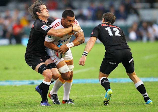 New Zealand Waikato Chiefs' Liam Messam (C) is tackled by Durban Sharks' Keegan Daniels (L) during a Super 15 rugby union match at the Mr Price Kings Park Rugby Stadium on April 21, 2012. AFP PHOTO (Photo credit should read -/AFP/Getty Images)