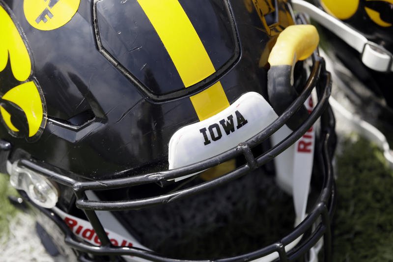 A helmet sits on the field before Iowa's NCAA college football spring game, Saturday, April 23, 2016, in Iowa City, Iowa. (AP Photo/Charlie Neibergall)
