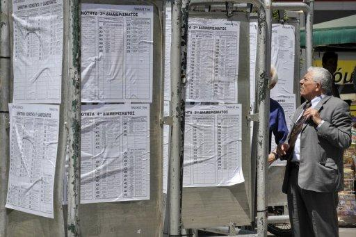 People are seen checking the lists of the polling stations on the eve of the Greek general elections in Athens, on May 5. Greece readies for elections with voters angry about austerity cuts and uncertainty over whether a new government can be formed with a strong enough mandate to push through yet more reforms demanded by its international creditors