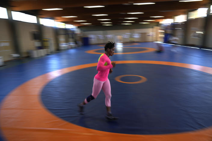 Guinean wrestler Fatoumata Yarie Camara runs at the end of her morning training session at the Ostia's Olympic training center in Ostia, near Rome, Monday, July 5, 2021. Coach Vincent Aka _ a former Olympian himself, managed to secure money for a two-week June training camp in Italy. A West African wrestler's dream of competing in the Olympics has come down to a plane ticket. Fatoumata Yarie Camara is the only Guinean athlete to qualify for these Games. She was ready for Tokyo, but confusion over travel reigned for weeks. The 25-year-old and her family can't afford it. Guinean officials promised a ticket, but at the last minute announced a withdrawal from the Olympics over COVID-19 concerns. Under international pressure, Guinea reversed its decision. (AP Photo/Alessandra Tarantino)