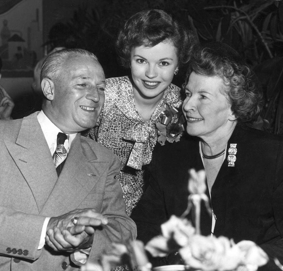 <p>Shirley's parents, Gertrude and George Temple, accompany her to a 20th Century Fox party to celebrate her return to the studio in <em>Mr. Belvedere Goes to College.</em> </p>
