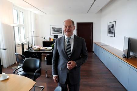 FILE PHOTO: German Finance Minister Olaf Scholz is pictured in his office during an interview with Reuters in Berlin
