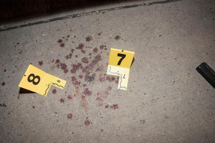 Bloodstains are seen next to markers outside the car of Philando Castile.