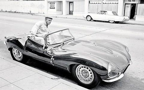 Steve McQueen gets into his Jaguar XKSS in Hollywood in June 1963 - Credit: John Dominis/Time & Life Pictures/Getty Images