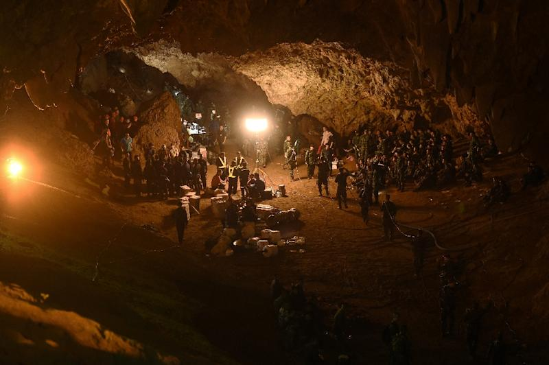 Rescuers worked through the night to try to reach a young football team and their coach who have been trapped inside a Thai cave since Saturday (AFP Photo/Lillian SUWANRUMPHA)