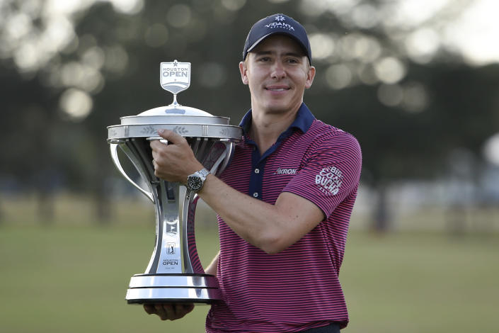 Carlos Ortiz holds the champion's trophy after winning the Houston Open golf tournament, Sunday, Nov. 8, 2020, in Houston. (AP Photo/Eric Christian Smith)