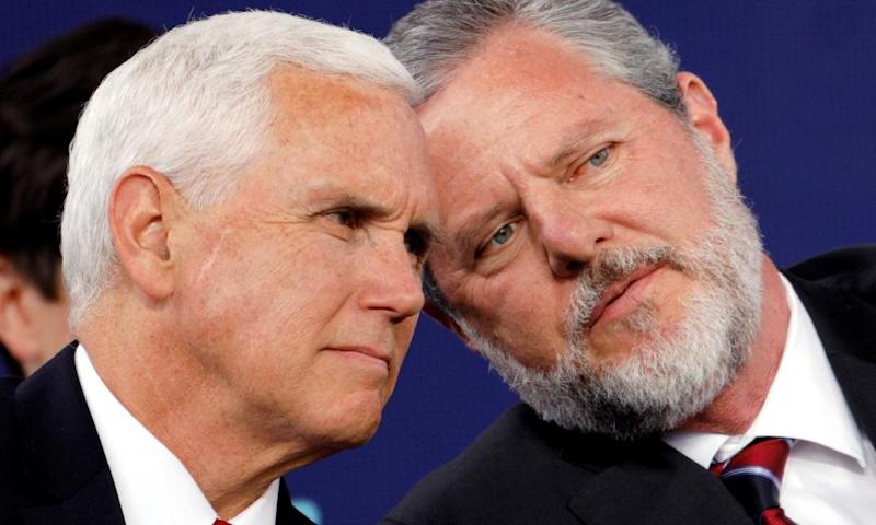 Jerry Falwell Jr confers with vice-president Mike Pence at Liberty University's commencement ceremony in Lynchburg, Virginia on Saturday.