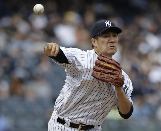 New York Yankees starting pitcher Masahiro Tanaka, of Japan, attempts to pick off a runner at first base during the third inning of a baseball game Saturday, May 3, 2014, in New York. (AP Photo/Frank Franklin II)