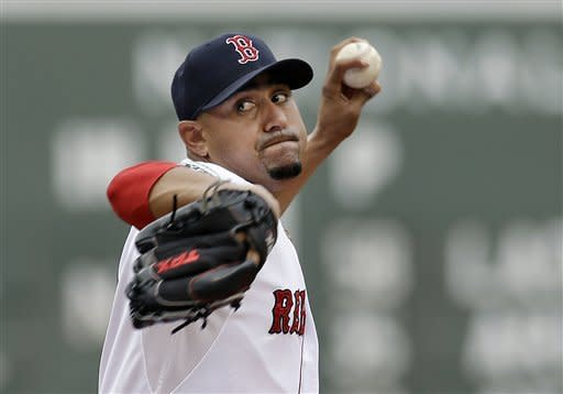 Boston Red Sox starting pitcher Franklin Morales delivers to the New York Yankees in the first inning of the first baseball game in a day-night doubleheader at Fenway Park in Boston, Saturday, July 7, 2012. (AP Photo/Elise Amendola)