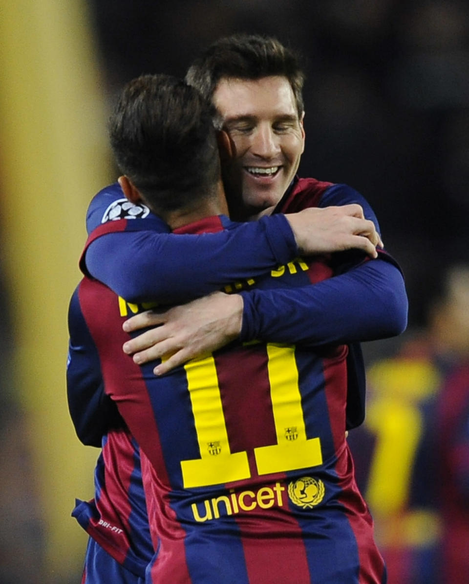 Barcelona's Neymar, rear, celebrates his side's 2nd goal with Lionel Messi during the Group F Champions League soccer match between FC Barcelona and PSG at the Camp Nou stadium in Barcelona, Spain, Wednesday Dec. 10, 2014. (AP Photo/Manu Fernandez)